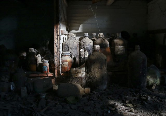 Thick dust covers chemical bottles in a laboratory at the abandoned former Union Carbide pesticide plant in Bhopal November 14, 2014. (Photo by Danish Siddiqui/Reuters)