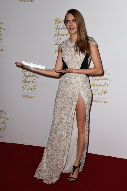 Model of the year Cara Delevingne poses with her award in the winners room at the British Fashion Awards at London Coliseum on December 1, 2014 in London, England. (Photo by Pascal Le Segretain/Getty Images)