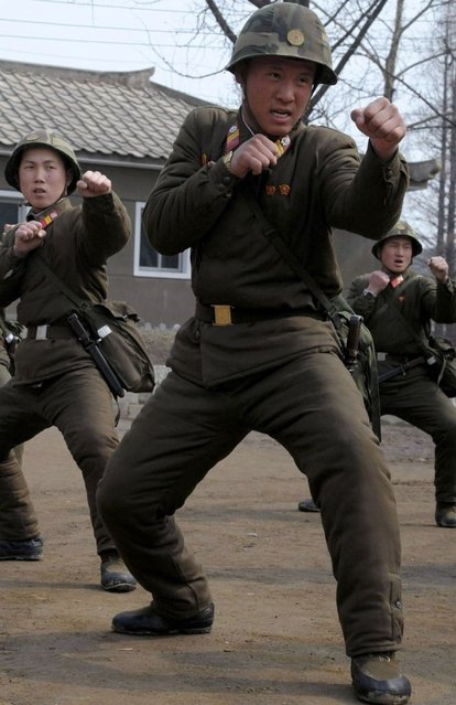 Soldiers of Kim Il Sung Military University perform military training on Wednesday, March 6, 2013, in Pyongyang, North Korea. North Korea's military is vowing to cancel the 1953 cease-fire that ended the Korean War, straining already frayed ties between Washington and Pyongyang as the United Nations moves to impose punishing sanctions over the North's recent nuclear test. (Photo by Kim Kwang Hyon/AP Photo)