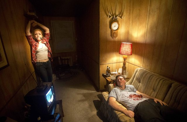 """Actors Ben Brotzman and Kali McMillian recreate a scene from the AMC television show """"The Walking Dead"""" for visitors to the """"Walking Dead- Experience Chapter 1"""" Friday, October 30, 2015, in Atlanta.  """"The Walking Dead Experience-Chapter 1"""" drops small groups of audience members into more than 10,000 square feet of sets and special effects designed to emulate the fear and chaos of the television show, organizers say. (Photo by John Bazemore/AP Photo)"""