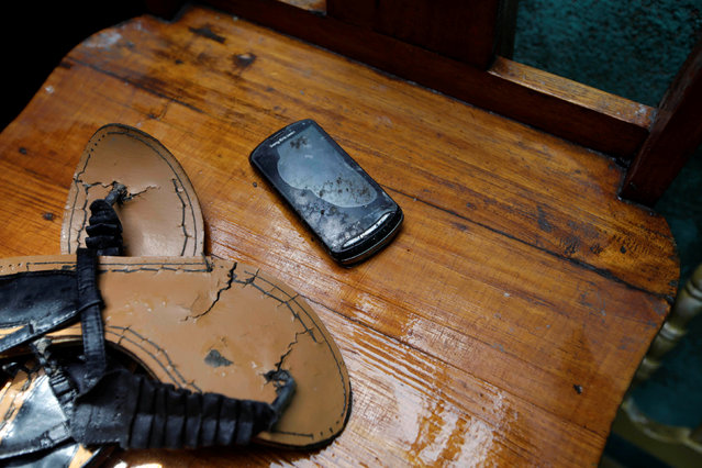 A water-damaged cell phone is seen in a house destroyed by Hurricane Matthew in Les Cayes, Haiti, October 5, 2016. (Photo by Andres Martinez Casares/Reuters)