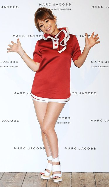 Japanese pop icon Ayumi Hamasaki, 35, wears a ruffle collared dress during a promotional event for the Marc Jacobs Iconic Showpieces Exhibition at Idol in Tokyo on Tuesday, April 2, 2013. The exhibition runs until April 14. (Photo by Jun Sato)