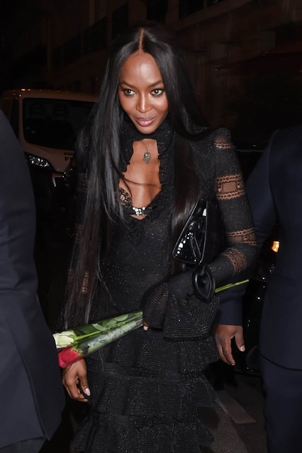 Supermodel Naomi Campbell is seen dining out with American R&B singer Usher during Paris Fashion Week in Paris, France on October 03, 2016. The British beauty, who was wearing a full-length, tiered black dress and high-heeled black sandals, was carrying roses and later entered her hotel alongside the singer. (Photo by FameFlynet UK)