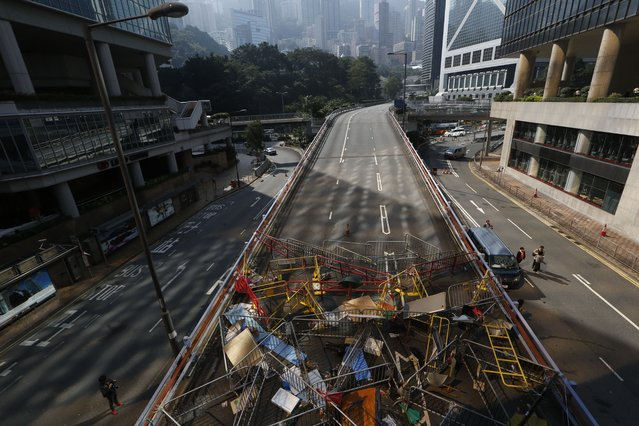 Barricades are set up by pro-democracy protester on a main road at the occupied area outside government headquarters in Hong Kong Tuesday, December 9, 2014. Hong Kong authorities and activists are set for one last showdown after the publication Tuesday of a court order authorizing the removal of barricades and tents blocking the Asian financial hub's streets for more than two months. (Photo by Kin Cheung/AP Photo)