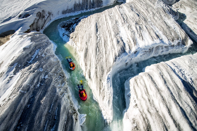 Water way to go. These incredible images show the moment two brave adventurers decided to body board down Europes longest glacier. Seen carving their way through the icy rivers of the Aletsch Glacier in Switzerland, the pair are seen risking their lives for an adrenalin rush of a whole new kind. (Photo by David Carlier/Caters News)