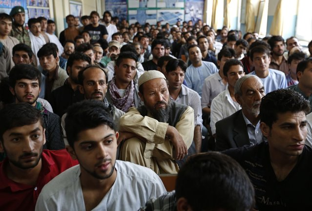Afghan men attend a driving license lesson before receiving a driving license at a Kabul traffic police department in Kabul August 23, 2014. (Photo by Mohammad Ismail/Reuters)