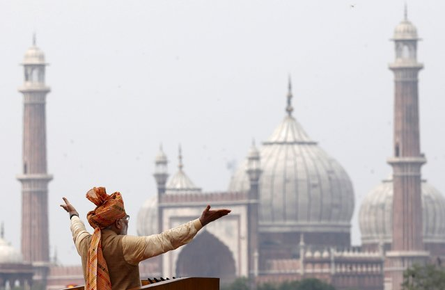 Indian Prime Minister Narendra Modi addresses the nation from the historic Red Fort during Independence Day celebrations in Delhi, India, in this August 15, 2015 file photo. Modi pledged 800 billion rupees ($12.10 billion) in funds to bolster development and economic growth in Kashmir, a year after the worst flooding in more than a century destroyed half a million homes there. (Photo by Adnan Abidi/Reuters)