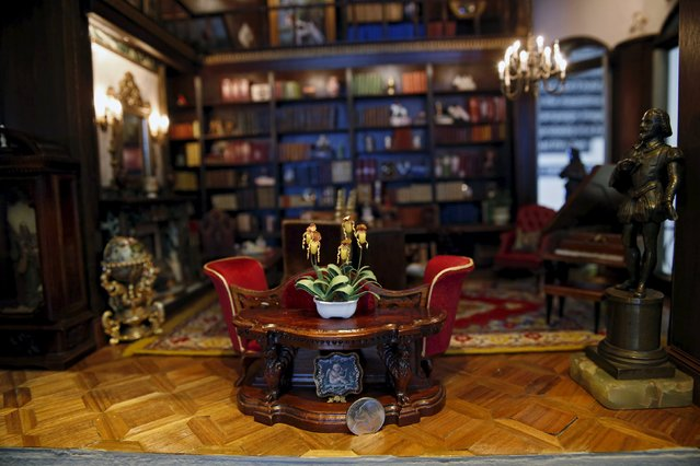 "Miniature books and furniture are displayed in the ""library"" of the Astolat Castle, a 3 metre (9 foot) tall dollhouse, currently on display in New York November 14, 2015. (Photo by Lucas Jackson/Reuters)"