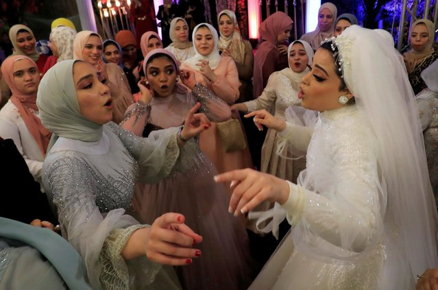 Bride Hager Yasser dances with guests during her traditional wedding celebration at the outdoor Grand Palace villa in Queisna, as Egyptian government only allows outdoor events amid the coronavirus disease (COVID-19) pandemic, in Egypt's northern Nile Delta province of Menoufia, Egypt on November 4, 2020. (Photo by Amr Abdallah Dalsh/Reuters)