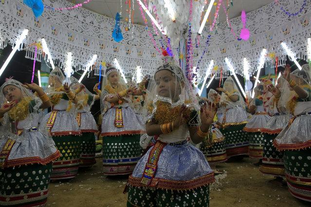 Young Manipuri girls perform the Madhur Ras dance at the Raas Leela festival, held to symbolise Sri Krishna's childhood in Moulvibazar, Bangladesh on November 25, 2015. (Photo by Muhammad Mostafigur Rahman/Demotix/Corbis)