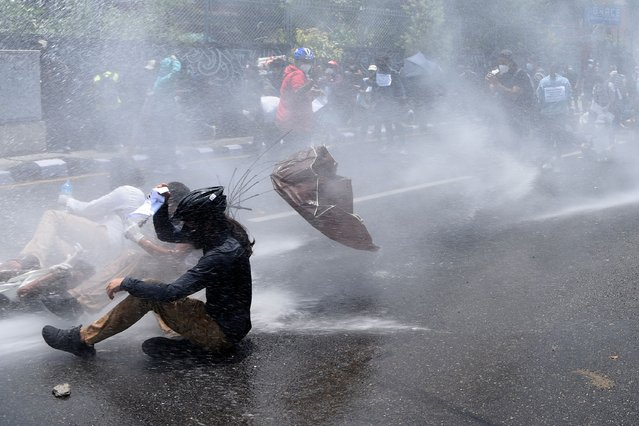 Police use water cannon to disperse demonstrators protesting against the governments policy on the fight against the COVID-19 coronavirus situation, in Kathmandu on June 9, 2020. (Photo by Prakash Mathema/AFP Photo)