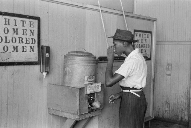 "A man drinks at a ""colored"" water cooler in a streetcar terminal in Oklahoma City, July 1939. (Photo by Reuters/Library of Congress)"