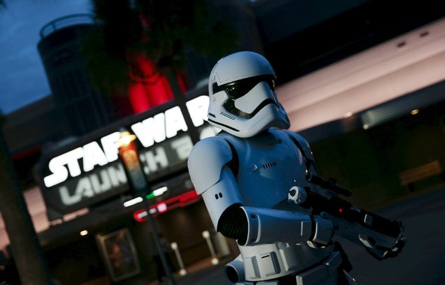 A person dressed as a stormtrooper patrols outside the Star Wars Launch Bay grand opening at Disney's Hollywood Studios in Orlando, Florida December 4, 2015. (Photo by Scott Audette/Reuters)