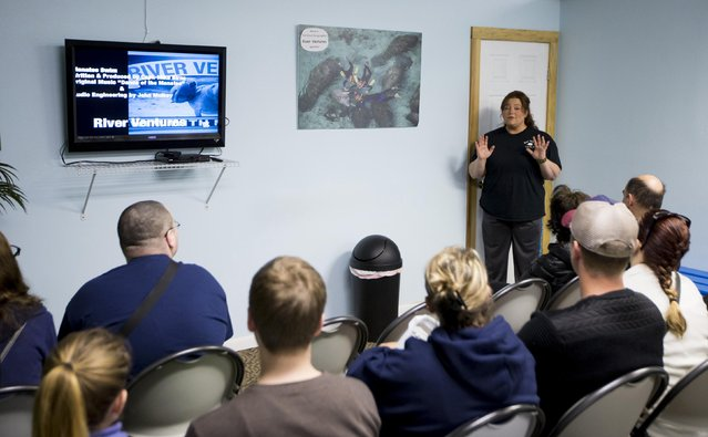 River Ventures tour operations manager Brandi Bruton gives the required orientation to guests before heading out to snorkel with the manatees at Three Sisters Springs in Crystal River, Florida January 15, 2015. (Photo by Scott Audette/Reuters)