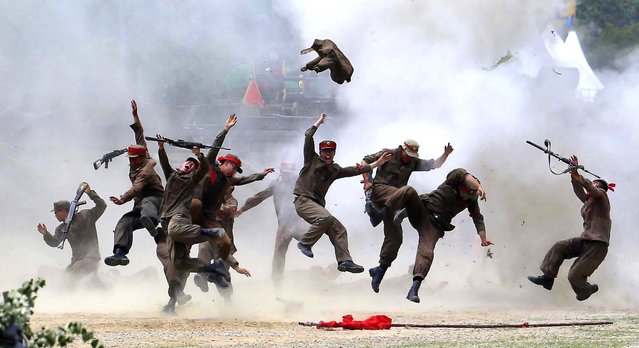 South Korean soldiers play their roles as North Koreans as they re-enact the battle of Chuncheon in Chuncheon, north of Seoul, on June 22, 2013. The country marks the 63rd anniversary of the beginning of the war on June 25. (Photo by Lee Jin-man/Associated Press)