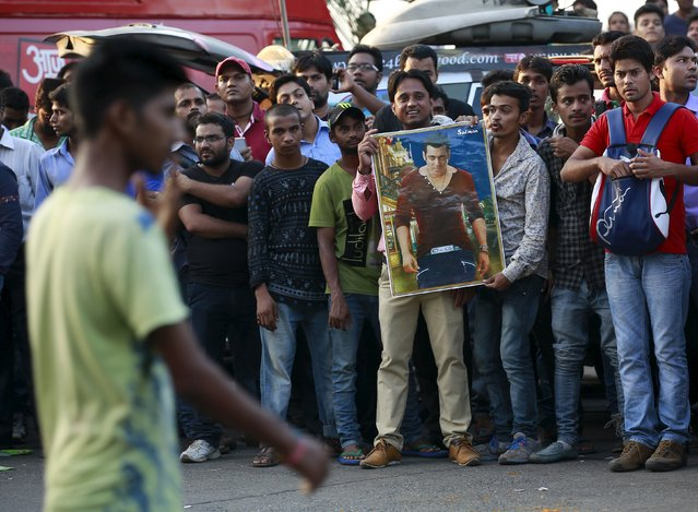 Fans of Bollywood actor Salman Khan hold his portrait as they celebrate outside his house in Mumbai, India, December 10, 2015. An Indian court on Thursday overturned Bollywood actor Salman Khan's conviction in a 13-year-old hit-and-run case, scrapping a lower court's sentence of five years in jail for running over a homeless man. (Photo by Danish Siddiqui/Reuters)