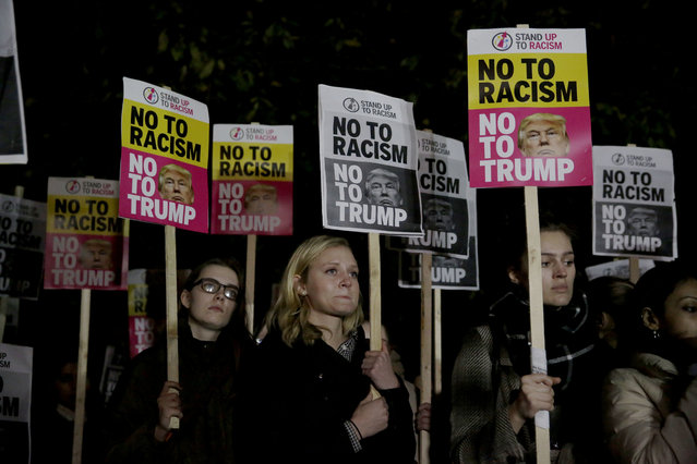 People hold placards as they take part in an anti-racism protest against President-elect Donald Trump winning the American election, outside the U.S. embassy in London, Wednesday, November 9, 2016. Democratic presidential candidate Hillary Clinton conceded her defeat to Republican Donald Trump after the hard-fought presidential election. (Photo by Matt Dunham/AP Photo)