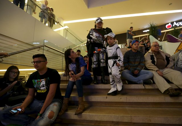 """People dressed as characters from Star Wars take part in an event held for the release of the film """"Star Wars: The Force Awakens"""" at a movie theater in Guatemala City, December 16, 2015. (Photo by Jorge Dan Lopez/Reuters)"""