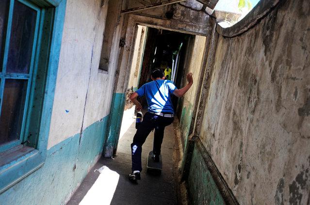 Joel Altamirano skates on a skateboard at the Comandos de Salvamento base in San Salvador, El Salvador August 10, 2016. (Photo by Jose Cabezas/Reuters)