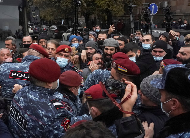 Armenian law enforcement officers scuffle with opposition protesters during a rally to demand the resignation of Prime Minister Nikol Pashinyan, following the signing of a deal to end a military conflict over Nagorno-Karabakh, in Yerevan, Armenia on December 10, 2020. (Photo by Artem Mikryukov/Reuters)