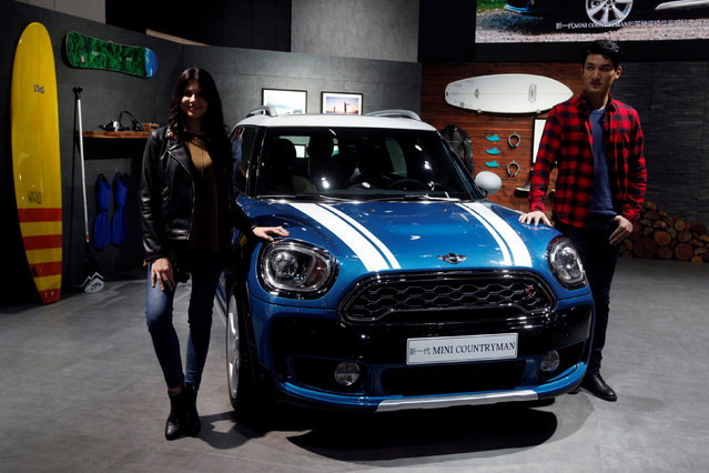 Models pose with a new Mini Countryman at China (Guangzhou) International Automobile Exhibition in Guangzhou, China November 18, 2016. (Photo by Bobby Yip/Reuters)
