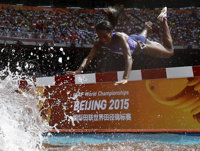 Rolanda Bell of Panama falls head first into the water obstacle during the women's 3000 metres steeplechase heats at the 15th IAAF World Championships in the National Stadium in Beijing, China August 24, 2015. (Photo by Kai Pfaffenbach/Reuters)