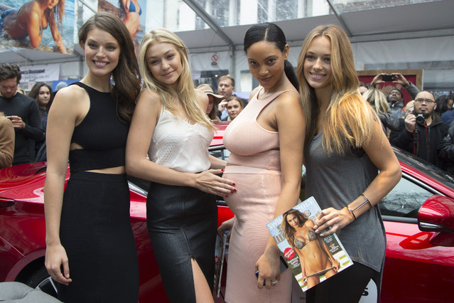 Sports Illustrated swimsuit models Emily DiDonato, Gigi Hadid, Ariel Meredith and Hannah Ferguson pose for a photo holding the Sports Illustrated swimsuit issue at the SwimCity festival in New York City on Monday February 9, 2015. (Photo by Gordon Donovan/Yahoo News)
