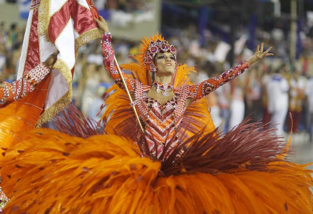 A reveller from the Salgueirol samba school participates in the annual carnival parade in Rio de Janeiro's Sambadrome, February 16, 2015. (Photo by Pilar Olivares/Reuters)