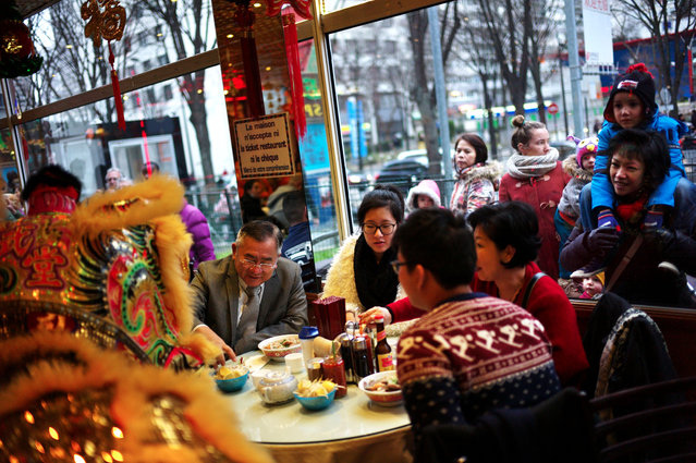 Lion dancers perform in a restaurant in the Chinatown district of Paris, to celebrate the Chinese New Year, Paris, Thursday, February 19, 2015. (Photo by Thibault Camus/AP Photo)