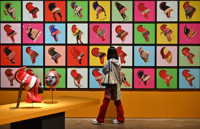 """This picture taken on March 31, 2021 shows a visitor looking at the art installation """"Outi Pieski"""" by Eeva-Kristiina Harlin during a preview of the 13th Gwangju Biennale at an exhibition hall in the southwestern city of Gwangju. (Photo by Jung Yeon-je/AFP Photo)"""
