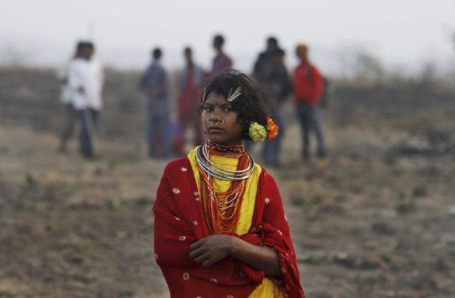 In this Saturday, February 21, 2015 photo, a member of India's Dongria tribe stands during the two-day long Niyamraja Festival atop the Niyamgiri hills near Lanjigarh in Kalahandi district, Orissa state, India. (Photo by Biswaranjan Rout/AP Photo)