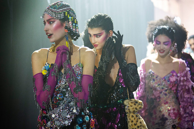 """Models prepare backstage ahead of the """"Romance Was Born"""" show during Afterpay Fashion Week Australia Resort 22 Collections at Carriageworks on May 31, 2021 in Sydney, Australia. (Photo by Jessica Hromas/The Guardian)"""