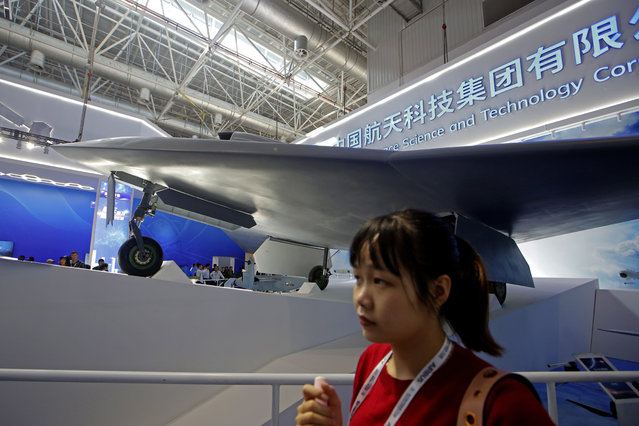 China new-generation stealth unmanned combat aircraft prototype, the CH-7, is displayed during the 12th China International Aviation and Aerospace Exhibition, also known as Airshow China 2018, Tuesday November 6, 2018, in Zhuhai city, south China's Guangdong province. (Photo by Kin Cheung/AP Photo)