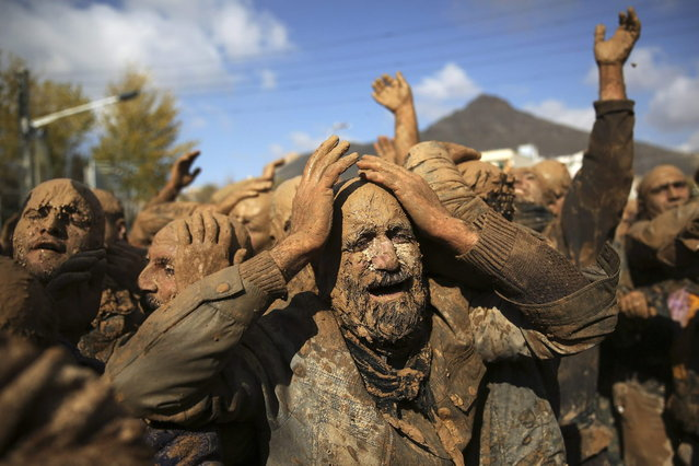Iranian Shiites cover themselves with mud, during Ashoura, marking the death anniversary of Imam Hussein, the grandson of Islam's Prophet Muhammad, at the city of Bijar, west of the capital Tehran, Iran, Thursday, November 14, 2013. (Photo by Ebrahim Noroozi/AP Photo)