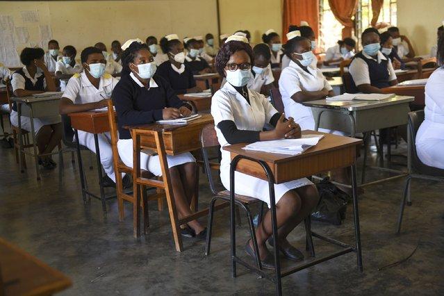 Nursing and midwifery students sit in class at St Joseph College of Nursing and Midwifery in Chiradzulu southern Malawi on Friday May 28, 2021. (Photo by Thoko Chikondi/AP Photo)