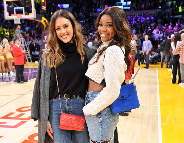 Actress Jessica Alba (L) and Gabrielle Union attend a basketball game between the Los Angeles Lakers and the Miami Heat at Staples Center on December 10, 2018 in Los Angeles, California. (Photo by Allen Berezovsky/Getty Images)