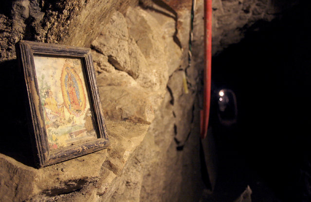 An image of the Virgin of Guadalupe is seen in a tunnel, nearly a mile long running into California from Tecate, Mexico, December 4, 2007. (Photo by Jorge Duenes/Reuters)