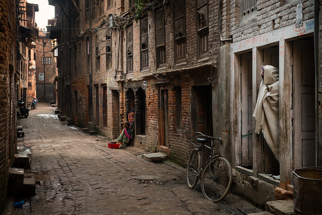 """""""Bhaktapur's Back Streets"""". Although Bhaktapur has a booming tourist trade, most of the residents are poor, eking out their living as laborers or farmers, and living in dilapidated Newari brick homes. This kind of poverty is typical of most Hindus living in Nepal and northern India. Photo location: Nepal. (Photo and caption by Michael Stetson/National Geographic Photo Contest)"""
