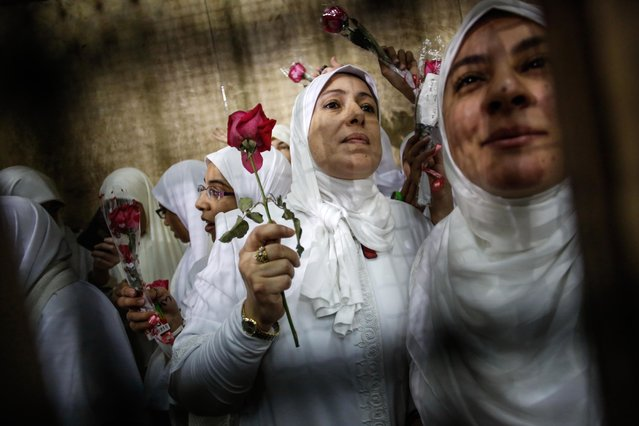 Female supporters of ousted President Mohammed Morsi stand inside the defendants' cage in a courtroom in Alexandria, Egypt on Saturday, December 7, 2013. A defense lawyer says an Egyptian appeal court has sentenced 14 women to a suspended year for protesting in support of Islamist-ousted President Mohammed Morsi, overturning a harsh sentence of 11 years that has caused an outcry. (Photo by Eman Helal/AP Photo)