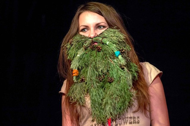 A woman wearing branches of plants poses during a Russia's beard and mustaches championship in central Moscow on April 4, 2015. (Photo by Alexander Utkin/AFP Photo)