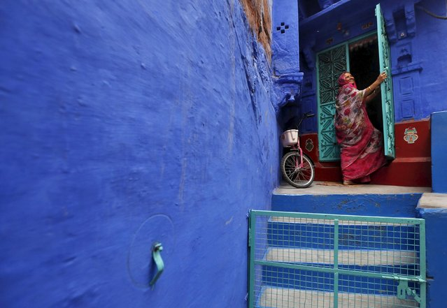 A woman stands on the doorstep of her house at Jodhpur in Rajasthan, April 6, 2015. (Photo by Adnan Abidi/Reuters)
