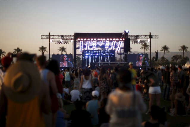 People watch Hozier perform at the Coachella Valley Music and Arts Festival in Indio, California April 11, 2015. (Photo by Lucy Nicholson/Reuters)