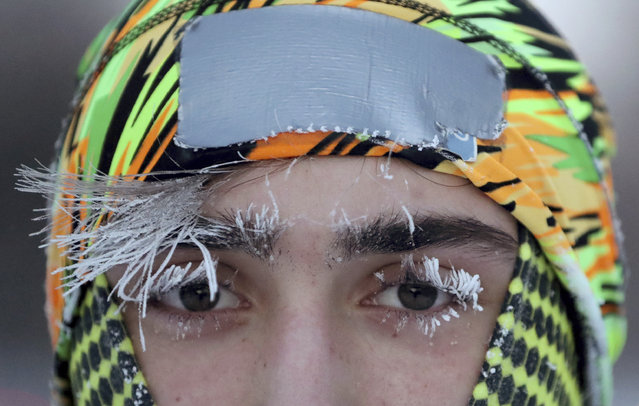 Frost covers part of the face of University of Minnesota student Daniel Dylla during a morning jog along Mississippi River Parkway Tuesday, January 29, 2019, in Minneapolis. Extreme cold and record-breaking temperatures are crawling into parts of the Midwest after a powerful snowstorm pounded the region, and forecasters warn that the frigid weather could be life-threatening. (Photo by David Joles/Star Tribune via AP Photo)