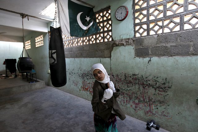 Mehek, 15, who has her hands wrapped, takes part in an exercise session at the first women's  boxing coaching camp in Karachi, Pakistan February 19, 2016. (Photo by Akhtar Soomro/Reuters)