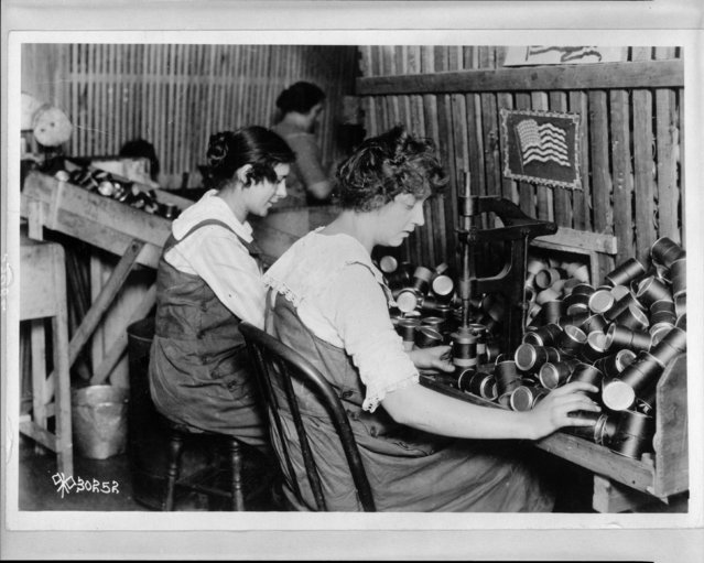 Women work in ordnance plants during World War I making fibre powder containers at W.C. Ritchie & Co. ib Chicago, Illinois, circa 1914-1918, in this Library of Congress handout photo. (Photo by Reuters/Bain Collection/Library of Congress)