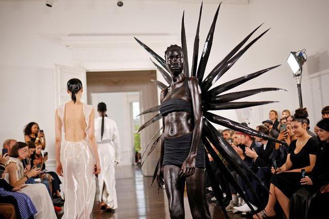 Models presents creations during a catwalk show for Fashion East during the Spring/Summer 2022 collection show on the fourth day of London Fashion Week in London on September 20, 2021. (Photo by Tolga Akmen/AFP Photo)