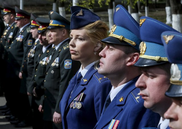 Ukrainian Air Force (R) and army officers attend a graduation ceremony at the National University of Defence of Ukraine in Kiev, Ukraine April 24, 2015. (Photo by Gleb Garanich/Reuters)