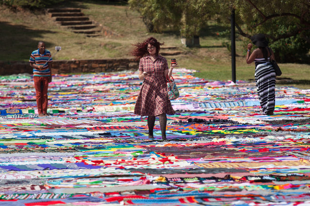 South Africans break the Guinness World record for the World's Largest Blanket at the Union Buildings on April 21, 2015 in Pretoria, South Africa. The handmade blanket was created by thousands of people across the globe who each knitted small portions. The idea for the blanket came in 2013 when Nelson Mandela's assistant, Zelda La Grange, who gave the organiser' Carolyn Steyn' a challenge to knit 67 blankets for Mandela Day. (Photo by Greatstock/Barcroft Media)