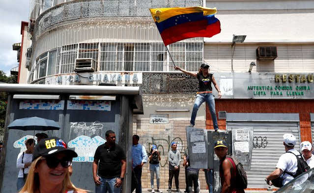 An opposition supporter waves a Venezuelan flag during a rally in Caracas, Venezuela on March 9, 2019. (Photo by Carlos Jasso/Reuters)