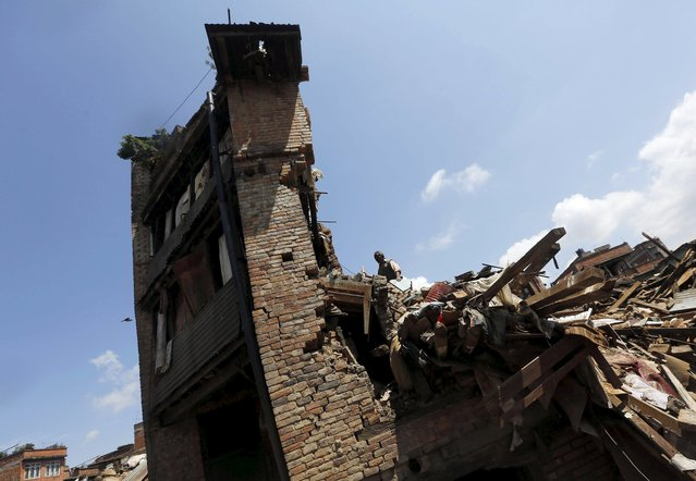 A man looks into his damaged house to recover belongings following Saturday's earthquake in Bhaktapur, Nepal April 27, 2015. (Photo by Adnan Abidi/Reuters)